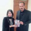 "Yusra Visaal is offering new poetry book "" Visaal Yar"" to PML-MNA Nasir Bosal"