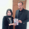"Yusra Visaal is offering new poetry book "" Visaal Yar"" to PML-MNA Nasir Bosal"