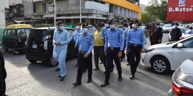 Islamabad police hold awareness walk to create awareness against coronavirus